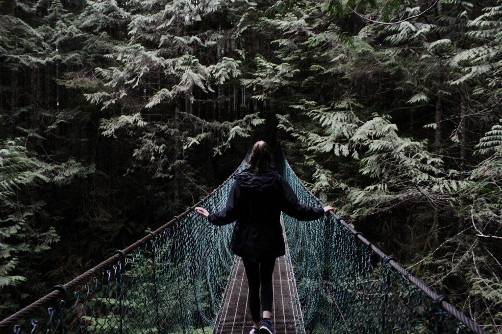 woman walking on rope bridge